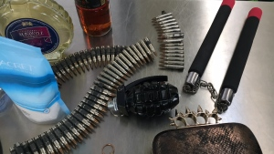A perfume container disguised as a hand grenade and other items recently seized by security guards at Pearson International Airport in Mississauga, Ont. are pictured on Tuesday, Dec. 4, 2018. (Craig Berry / CTV Toronto)