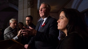 Minister of Justice and Attorney General of Canada Jody Wilson-Raybould (right) looks on as Minister of Border Security and Organized Crime Reduction Bill Blair speaks about drinking and driving laws during a news conference in Ottawa, Tuesday December 4, 2018. THE CANADIAN PRESS/Adrian Wyld