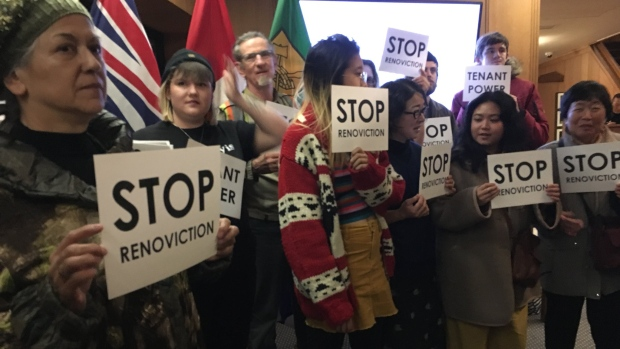 Anti-renoviction protesters are seen at Vancouver City Hall on Dec. 4, 2018.