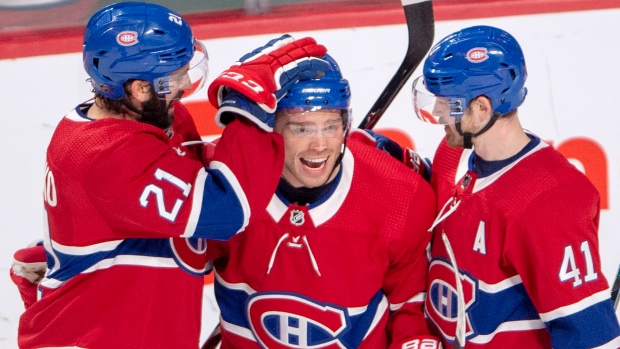 Montreal Canadiens left wing Max Domi, center, celebrates with teammates David Schlemko (21) and Paul Byron (41) after scoring the second goal against the Ottawa Senators during second period NHL hockey action Tuesday, December 4, 2018 in Montreal. THE CANADIAN PRESS/Ryan Remiorz