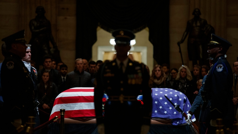 Members of the public pay their respects to former US President George H.W. Bush at the Rotunda of the US Capitol in Washington, DC, USA, 04 December 2018. EPA/TING SHEN