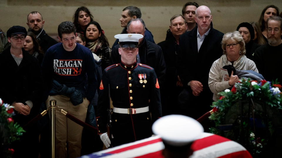 Members of the public pay their respects to former US President George H.W. Bush in the Rotunda of the US Capitol in Washington, DC, USA, 05 December 2018. EPA/SHAWN THEW