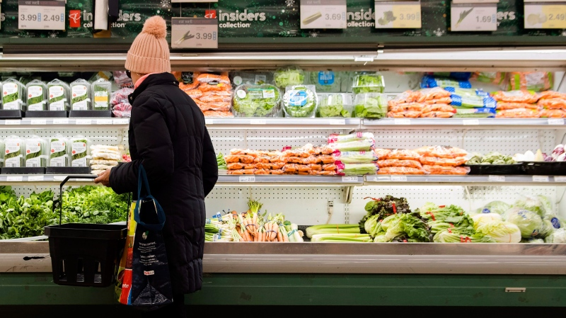 A women overlooks produce in a grocery store in Toronto on Friday, Nov. 30, 2018. (THE CANADIAN PRESS/Nathan Denette)