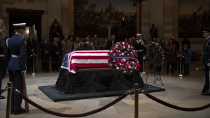 The last visitors pay respects to the late president, George H.W. Bush, as the public viewing comes to an end at the U.S. Capitol Rotunda, on Dec. 5, 2018. (J. Scott Applewhite / AP)