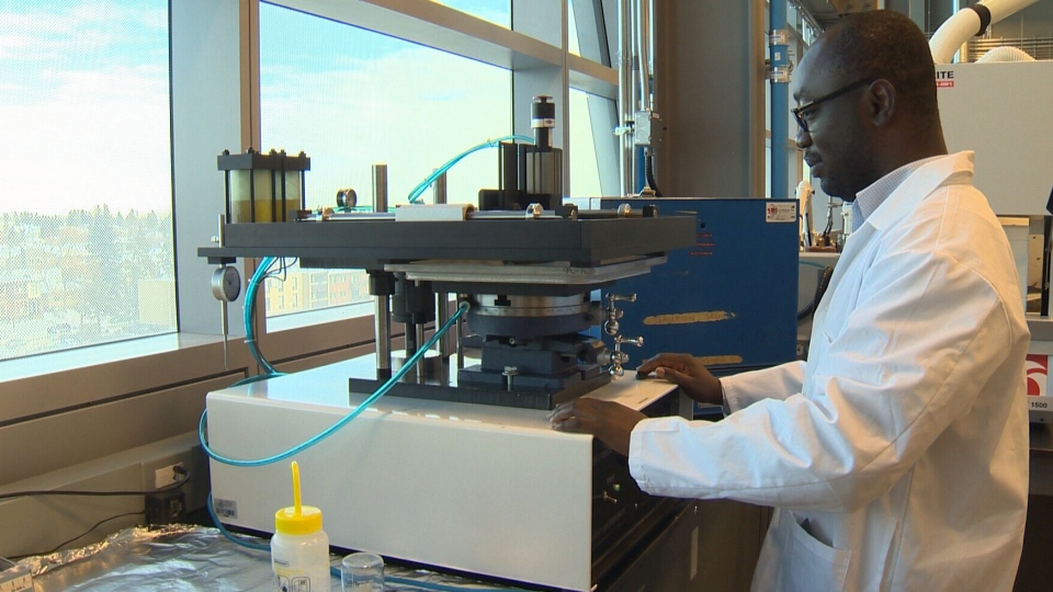 Postdoctoral researcher Paul Addo is seen in a lab at the University of Calgary.