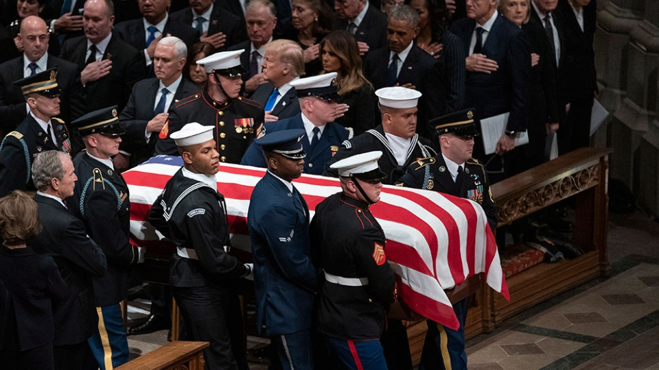 The flag-draped casket of former U.S. President George H.W. Bush is carried by a military honor guard during a State Funeral at the National Cathedral, Wednesday, Dec. 5, 2018, in Washington. (AP Photo/Carolyn Kaster)