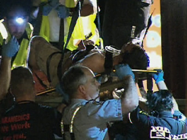 Toronto EMS transport the 28-year-old man after he was dragged by a train about  six kilometres through west-end Toronto, early Monday, July 13, 2009.