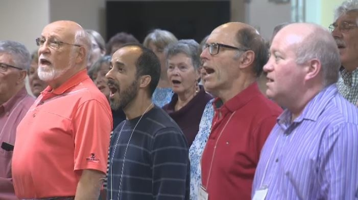 Members of the Arbutus Singers, a choir that has existed for more than two decades, rehearse. Dec. 5, 2018. (CTV Vancouver Island)