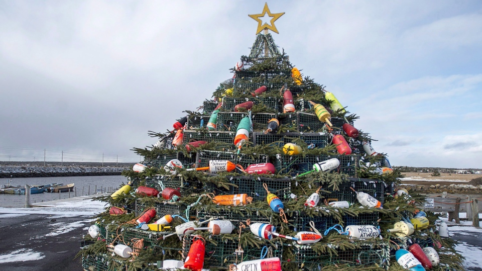 A Christmas tree made of lobster traps is seen on Cape Sable Island, on Nova Scotia's South Shore, on December 11, 2016. They first started appearing along Canada's east coast about 10 years ago: towering artificial Christmas trees made from carefully stacked lobster traps. Adorned with colourful buoys, twinkling lights and evergreen boughs, they are becoming regular fixtures in fishing communities across Atlantic Canada. (THE CANADIAN PRESS/Andrew Vaughan)