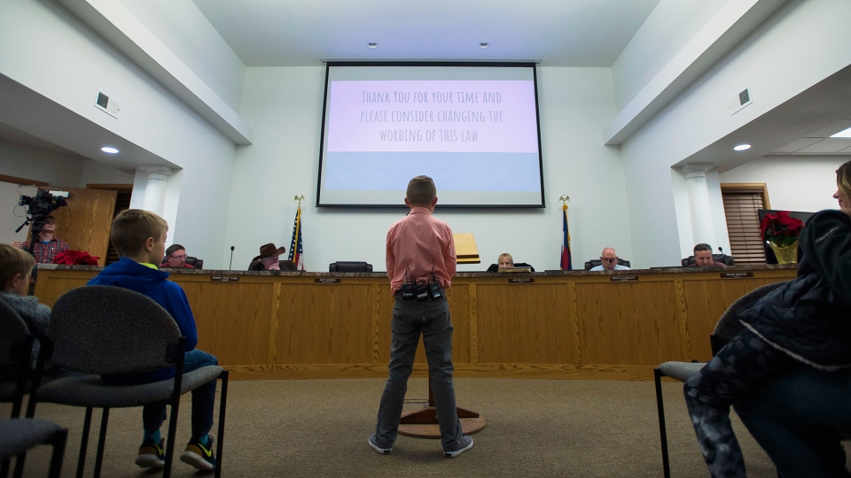 Range View Elementary School third grader Dane Best presents his argument to town board trustees to change a law in Severance that bans snowball fights on Monday, Dec. 3, 2018, at the Town Hall in Severance, Colo. (Timothy Hurst / The Coloradoan via AP)