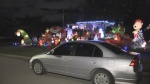 A car stops to look at a massive holiday display in south London, Ont. on Tuesday, Dec. 4, 2018. (Sean Irvine / CTV London)