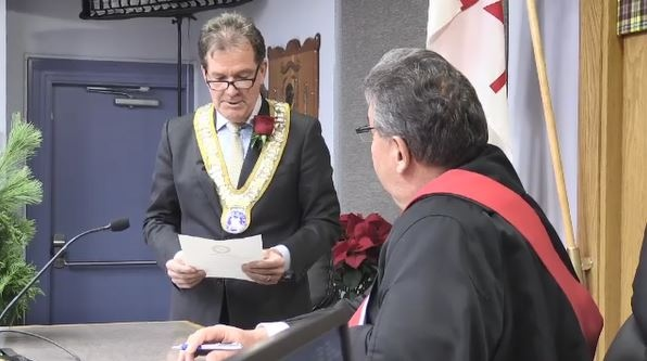 New Timmins Mayor George Pirie being sworn in
