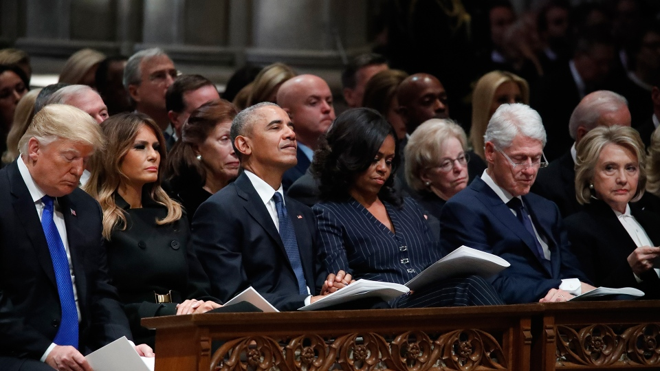 From left, U.S. President Donald Trump, first lady Melania Trump, former President Barack Obama, Michelle Obama, former President Bill Clinton and former Secretary of State Hillary Clinton listen during a State Funeral at the National Cathedral, Wednesday, Dec. 5, 2018, in Washington, for former President George H.W. Bush. (AP / Alex Brandon, Pool)