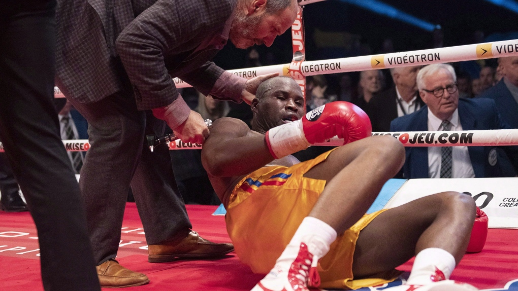 Marc Gagne, left, checks on Adonis Stevenson