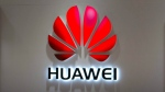 A Huawei logo is seen at a Huawei store at a shopping mall in Beijing Wednesday, July 4, 2018. (AP Photo/Mark Schiefelbein)