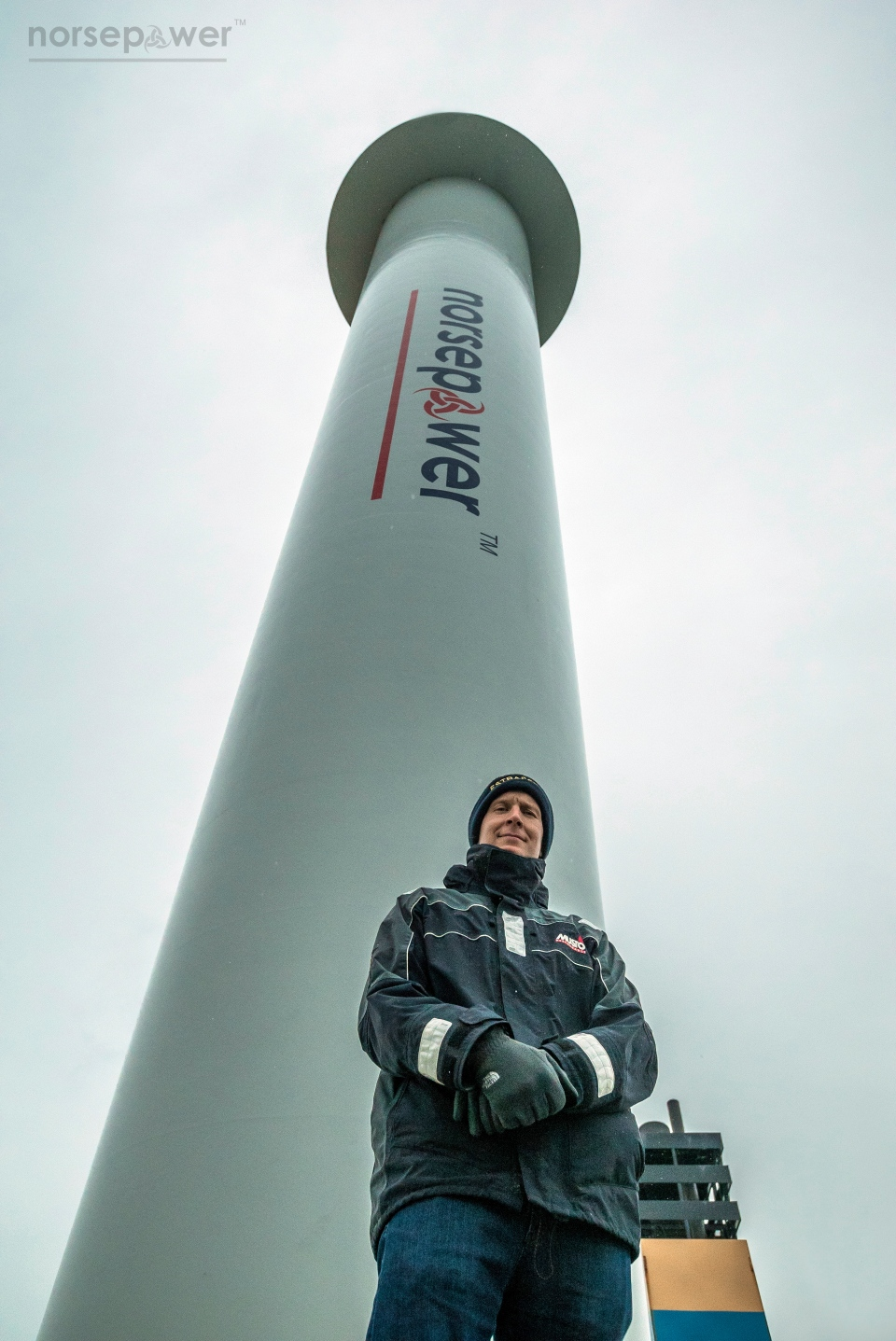 Tuomas Risk, CEO of Finnish startup company Norsepower, poses Nov. 2016, in the North Sea, in front of one of his company's rotor sails, one of the new technologies the shipping industry is looking at as it searches for new solutions to cut greenhouse gas emissions to combat climate change. (Norsepower via AP)