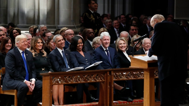 From left, U.S. President Donald Trump, first lady Melania Trump, former President Barack Obama, Michelle Obama, former President Bill Clinton, former Secretary of State Hillary Clinton, and former President Jimmy Carter listen as former Sen. Alan Simpson, R-Wyo., speaks during a State Funeral at the National Cathedral, Wednesday, Dec. 5, 2018, in Washington, for former President George H.W. Bush. (AP Photo/Alex Brandon, Pool)