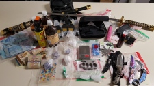 Drugs, cash and weapons after a search warrant