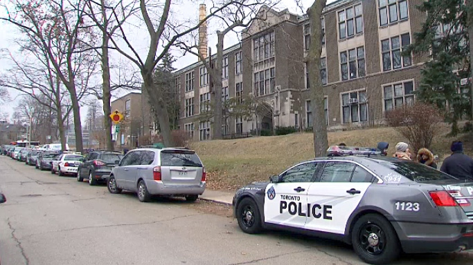 Toronto police investigate reports of a man with a gun inside a High Park-area school on Dec. 6, 2018.