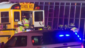 This frame grab from video by WEEK/WHOI shows emergency personnel entering the back of a school bus that collided with a semitrailer that was headed the wrong way on an interstate late Wednesday, Dec. 5, 2017, near Downs, Ill. (WEEK / WHOI via AP)