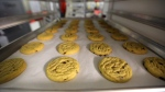 FILE -- In this June 19, 2014 photo, freshly baked cannabis-infused cookies cool on a rack inside Sweet Grass Kitchen, a well-established gourmet marijuana edibles bakery which sells its confections to retail outlets, in Denver. (AP Photo/Brennan Linsley)