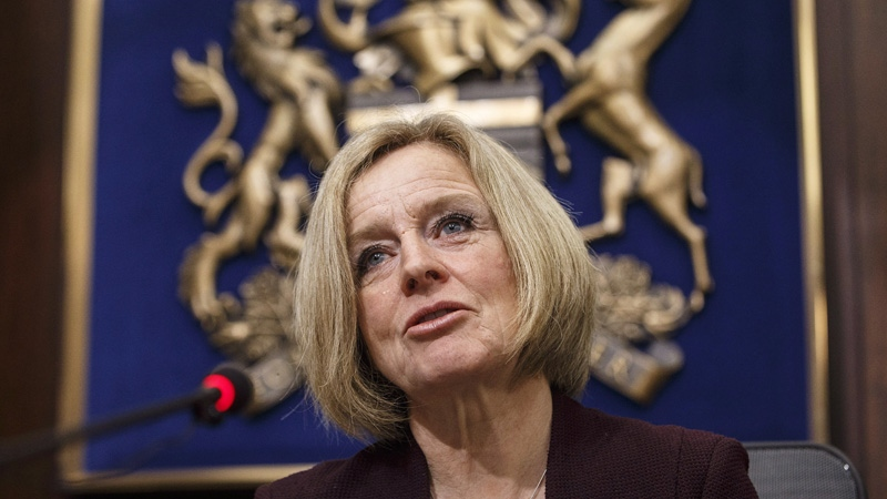 Alberta Premier Rachel Notley speaks to cabinet members about an 8.7 percent oil production cut to help deal with low prices, in Edmonton on Monday December 3, 2018. THE CANADIAN PRESS/Jason Franson