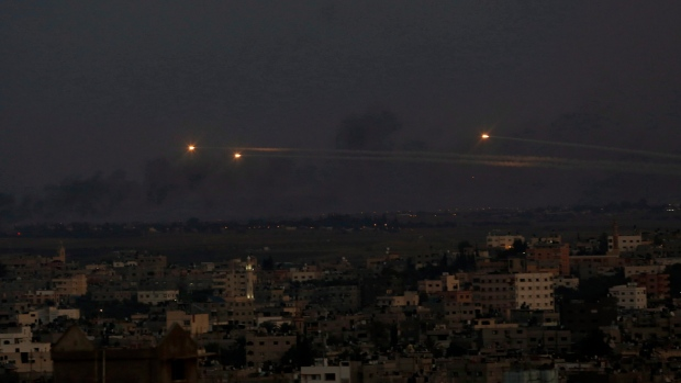 Palestinian rockets cross the sky
