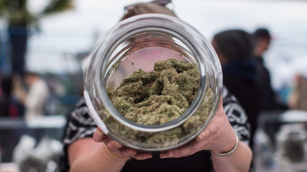 A vendor displays marijuana for sale during the 4-20 annual marijuana celebration in Vancouver on April 20, 2018. (THE CANADIAN PRESS/Darryl Dyck)