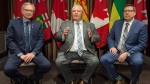 Ontario Premier Doug Ford, centre, speaks to reporters as Saskatchewan Premier Scott Moe, right, and New Brunswick Premier Blaine Higgs look on during a meeting of Canada's premiers in Montreal, Thursday, December 6, 2018. THE CANADIAN PRESS/Graham Hughes
