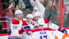 Montreal Canadiens right wing Brendan Gallagher celebrates a goal with teammates while playing the Ottawa Senators, in Ottawa on Thursday, Dec. 6, 2018. (THE CANADIAN PRESS/Sean Kilpatrick)