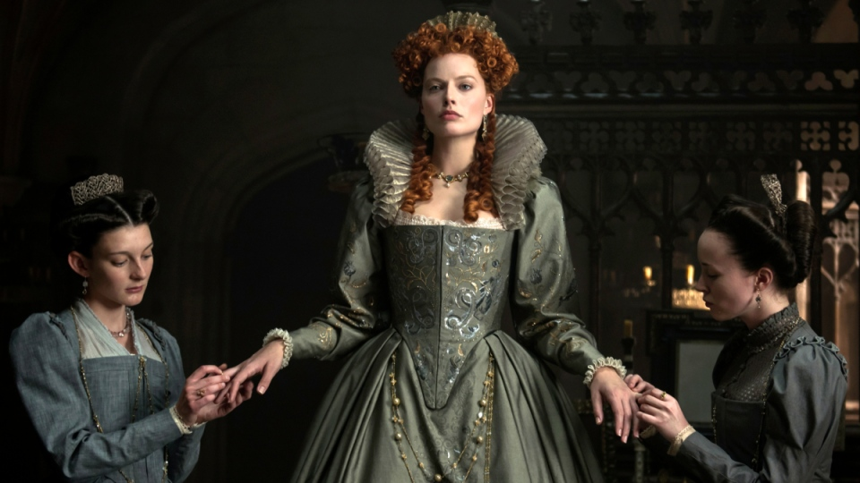 From left, Grace Molony as Dorothy Stafford, Margot Robbie as Queen Elizabeth I and Georgia Burnell as Kate Carey in a scene from 'Mary Queen of Scots.' (Parisa Tag / Focus Features via AP)