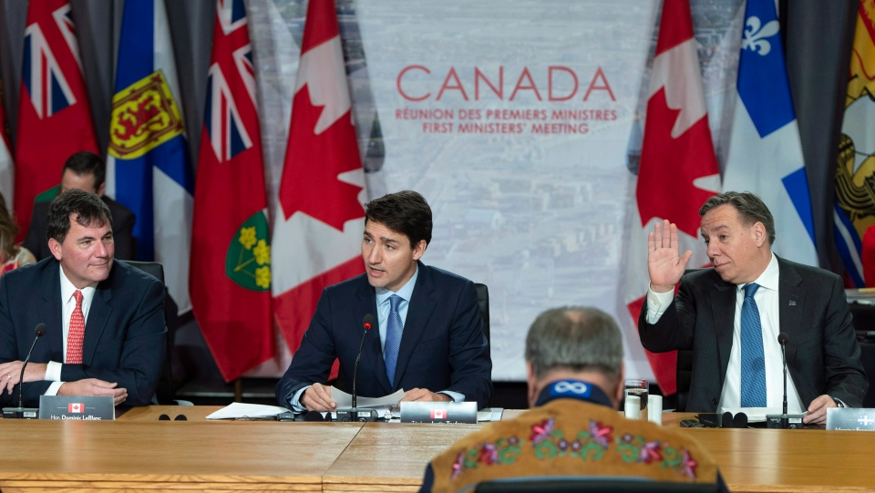 Prime Minister Justin Trudeau addresses the first session of the first ministers meeting flanked by Quebec Premier Francois Legault, right, and Intergovernmental Affairs Minister Dominic LeBlanc in Montreal on Friday, December 7, 2018. THE CANADIAN PRESS/Paul Chiasson