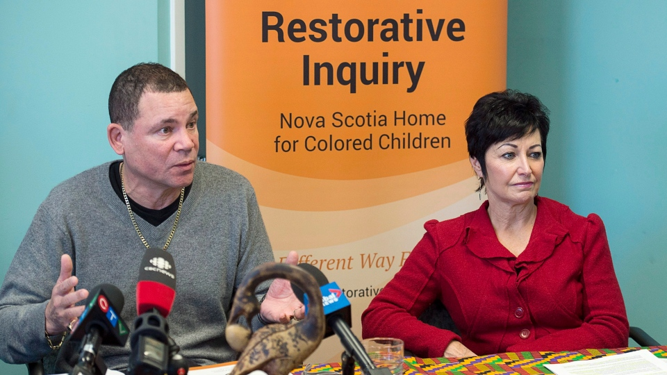 Tony Smith, left, a former resident, and Pamela Williams, chief judge of the provincial and family court, discuss an interim report from the Nova Scotia Home for Colored Children Restorative Inquiry, in Halifax on Friday, Dec. 7, 2018. (THE CANADIAN PRESS/Andrew Vaughan)