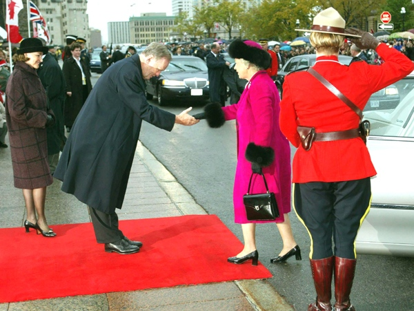 Queen Elizabeth II is greeted by Canadian Prime Minister Jean Chretien and his wife Aline as she arrives on Parliament Hill for an interfaith service, in Ottawa
