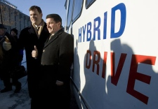Environment minister John Baird and Natural Resources minister Gary Lunn (right) arrive on a hybrid powered bus to announce clean energy initiatives at a news conference in Ottawa Wednesday Jan. 17, 2007. (CP / Tom Hanson)