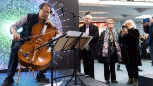 Cellist Yo-Yo Ma performs at a subway station in Montreal, Saturday, December 8, 2018. THE CANADIAN PRESS/Graham Hughes