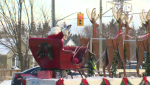 The big man in red waves to the crowd at he St. Agatha Santa Claus parade. (Dec. 8, 2018)