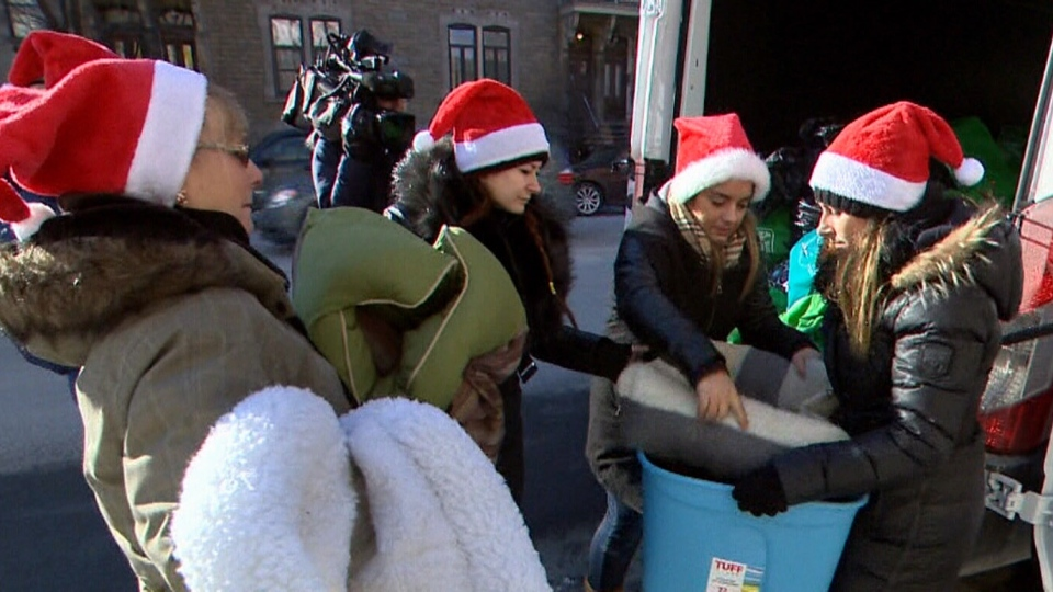 On Saturday, sisters Samantha and Sara Capobianco, along with a group of friends, started distributing bags filled with cold-weather necessities such as blankets, boots, socks, jackets and hats as well as items for pets, like dog beds, to homeless people in Montreal. (CTV Montreal)