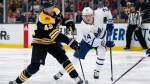 Boston Bruins' David Backes (42) takes a shot as Toronto Maple Leafs' Kasperi Kapanen (24) defends during the second period of an NHL hockey game in Boston, Saturday, Dec. 8, 2018. (AP Photo/Michael Dwyer)