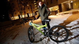 Emad Tamo, the Yazidi boy whose photo went viral after he was freed from ISIS and eventually reunited with his mother in Winnipeg, Manitoba is photographed with his new bike outside his home at Immigrant and Refugee Community Organization of Manitoba (IRCOM) Wednesday, December 5, 2018. (THE CANADIAN PRESS / John Woods)