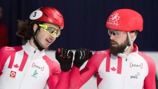 Samuel Girard, left, and Charles Hamelin, of Canada, react after their 1000-metre quarter-final at the ISU world short-track speedskating championships in Montreal, Sunday, March 18, 2018. THE CANADIAN PRESS/Graham Hughes