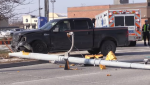 A crash between a car and pickup truck on Hespeler Rd. knocked down a traffic light. (Dec. 9, 2018)