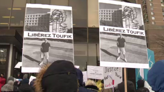 Protesters gather in support of Toufik Benhamiche, a Montreal-area man who has been stuck in Cuba for over a year after being involved in a boating incident that left another tourist dead, on Sun. Dec. 9, 2018.