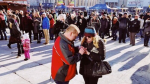 Derek LeRoux proposes to Jeanette Heyblom at the Christkindl Market. (Instagram: dtkitchener)