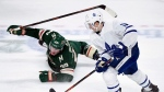 Minnesota Wild defenceman Ryan Suter (20) watches as Toronto Maple Leafs left wing Zach Hyman (11) takes the puck during the third period of an NHL hockey game Saturday, Dec. 1, 2018, in St. Paul, Minn. Hyman had a hearing with the NHL department of player safety on Sunday following his hit on Boston Bruins defenceman Charlie McAvoy.THE CANADIAN PRESS/AP /Hannah Foslien