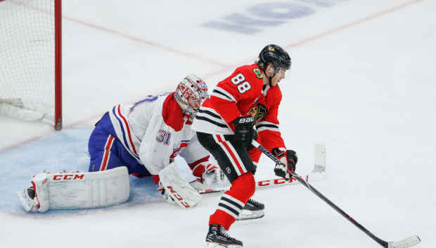 Chicago Blackhawks right wing Patrick Kane (88) looks to score against Montreal Canadiens goaltender Carey Price (31) during the third period of an NHL hockey game Sunday, Dec. 9, 2018, in Chicago. (AP Photo/Kamil Krzaczynski)