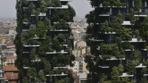 In this picture taken on Aug. 3, 2017 a partial view of the vertical forest residential towers at the Porta Nuova district, in Milan, Italy. (AP Photo/Luca Bruno)