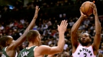 Toronto Raptors forward Kawhi Leonard (2) looks for the shot as Milwaukee Bucks centre Brook Lopez (11) and Milwaukee Bucks forward Khris Middleton (22) defend during first half NBA basketball action in Toronto on Sunday, Dec. 9, 2018. THE CANADIAN PRESS/Frank Gunn