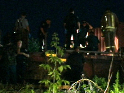 EMS works to help the 28-year-old man after he was dragged by a train about six kilometres, early Monday, July 13, 2009.