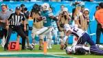 Miami Dolphins running back Kenyan Drake (32) scores to defeat the New England Patriots at Hard Rock Stadium in Miami Gardens on Sunday, Dec. 9, 2018. (Al Diaz/Miami Herald via AP)